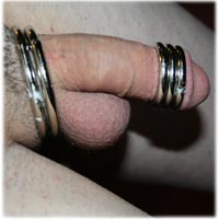 Metal Rings on Crossdresser Cock